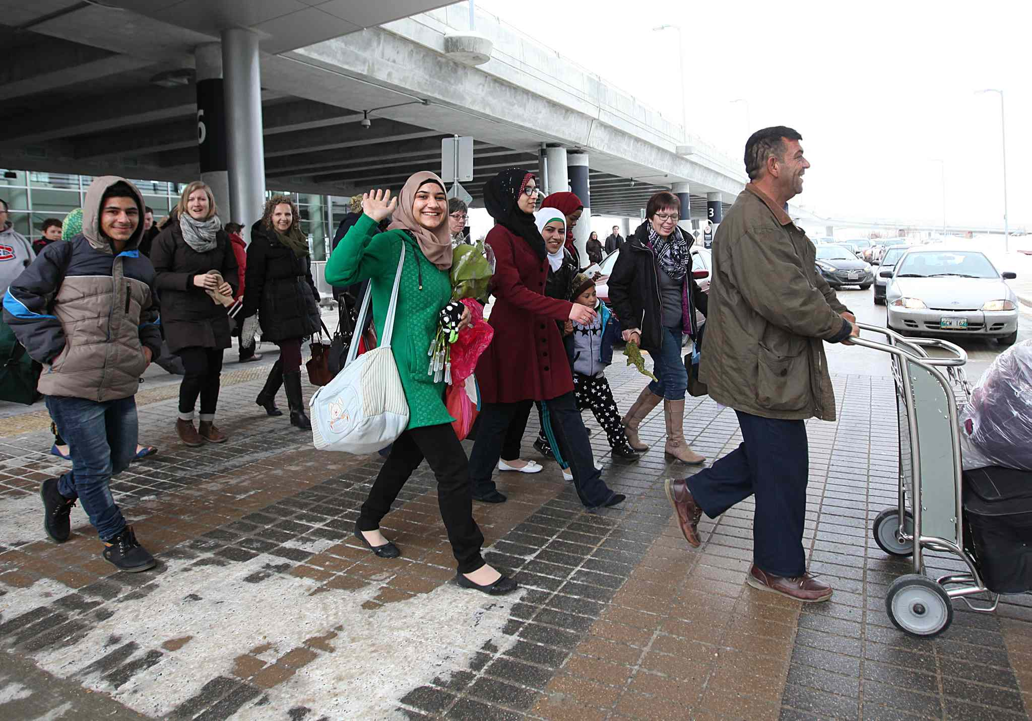 One of the first families to arrive into Winnipeg  from Syria leave Richardson Airport with smiles on their faces Saturday. More info coming. Dec 19, 2015 Ruth Bonneville / Winnipeg Free Press
